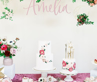 Floral first birthday cakes