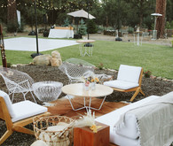 boho lounge area in woodland wedding