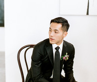 modern black groom's suit