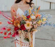 colorful bridal bouquet with feathers