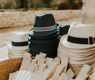 hat and fans for wedding ceremony