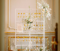 Champagne escort card display with gold drink stirs