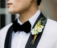 white tux with yellow boutonniere