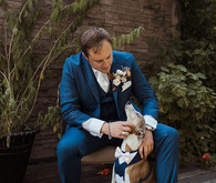 groom with dog