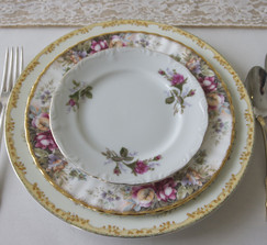mismatched vintage china and decor for rent