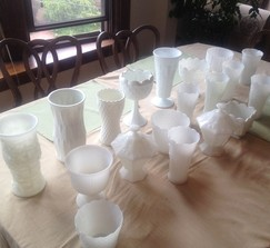 Large and medium milk glass vases