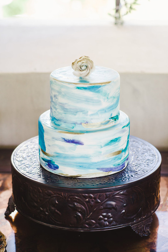 Two tiered blue and turquoise hand painted watercolor cake