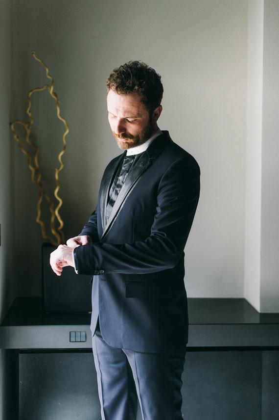 Dark blue grooms suit