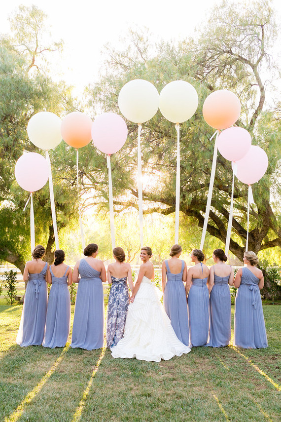 bride with bridesmaid in blue dresses