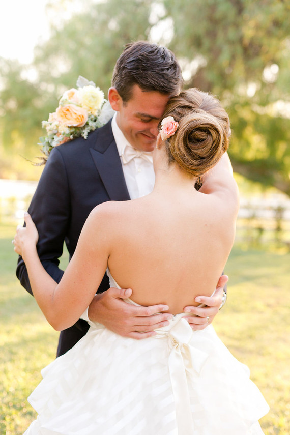 New couple with black suit and halter wedding gowns