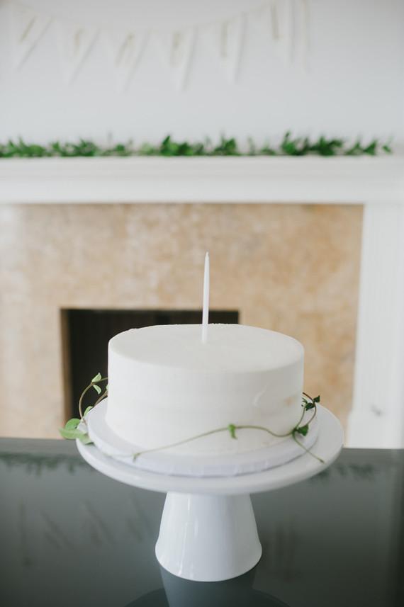 white 1st birthday cake