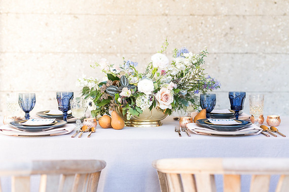 Soft blue spring wedding tablescape
