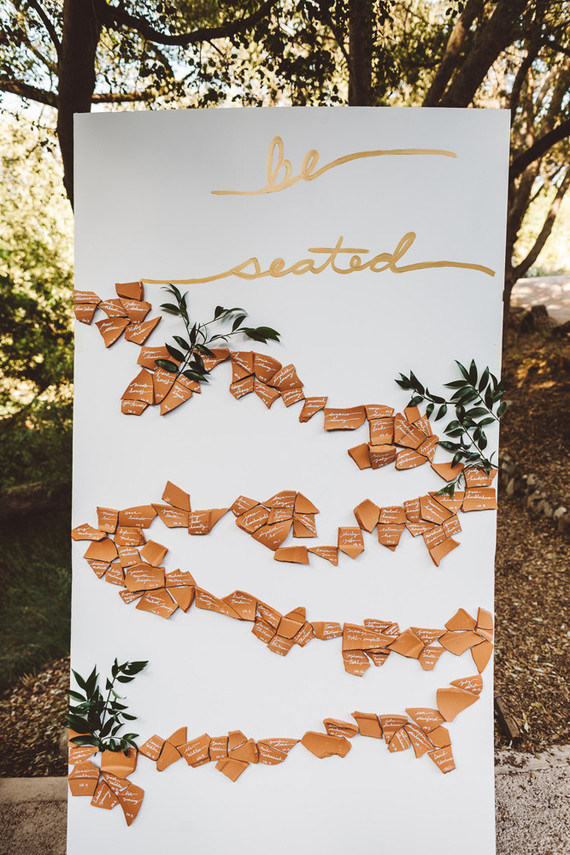 Whimsical escort card signage