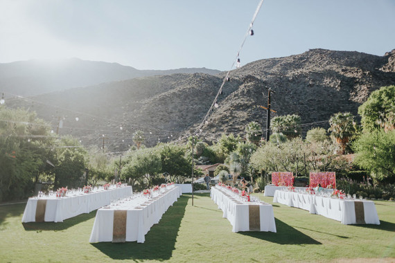 Pink and white reception tables