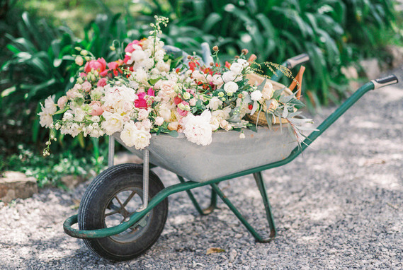 flower filled wheel barrow