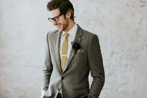 Groom in a grey suit