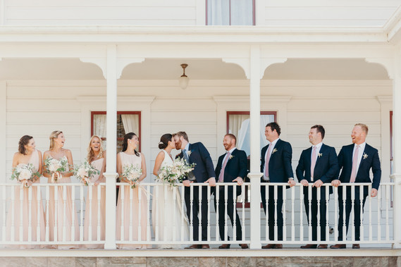 Farmhouse wedding party portrait