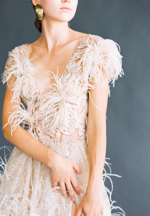 white feather wedding dress