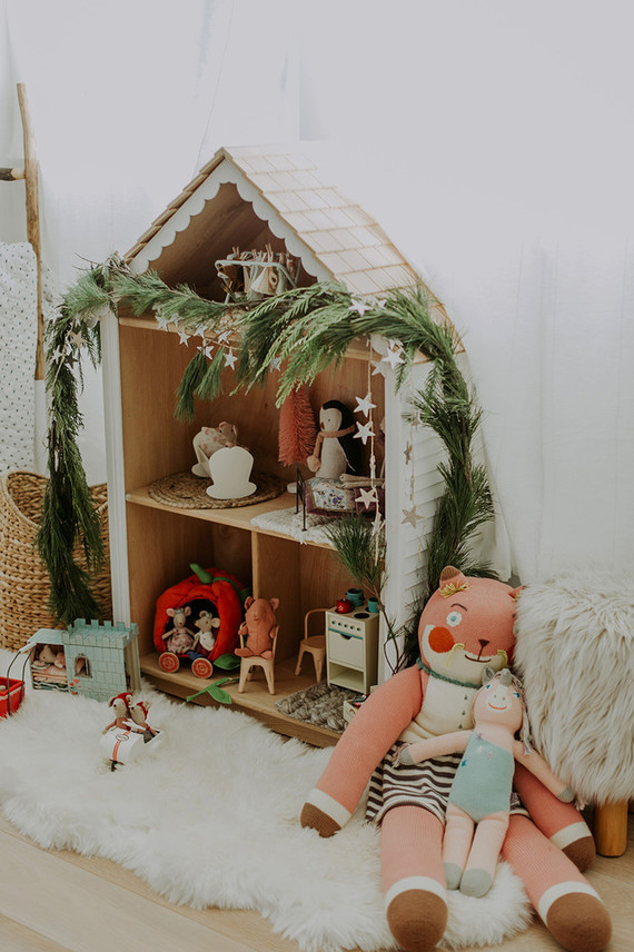 Doll house decorated for Christmas