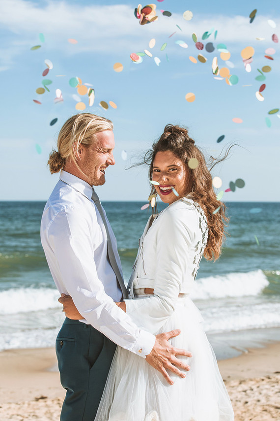 Surf inspired beach wedding in Montauk with the world's cutest dress