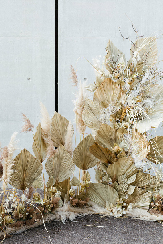 Modern french tropical wedding installation with dried flowers