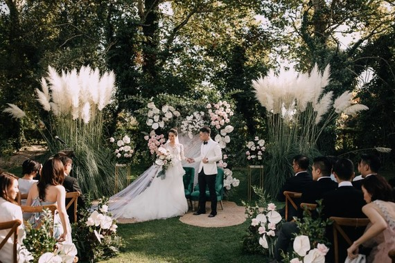 A moody dream garden wedding for a fashion forward couple at Palacio Villahermosa in Spain