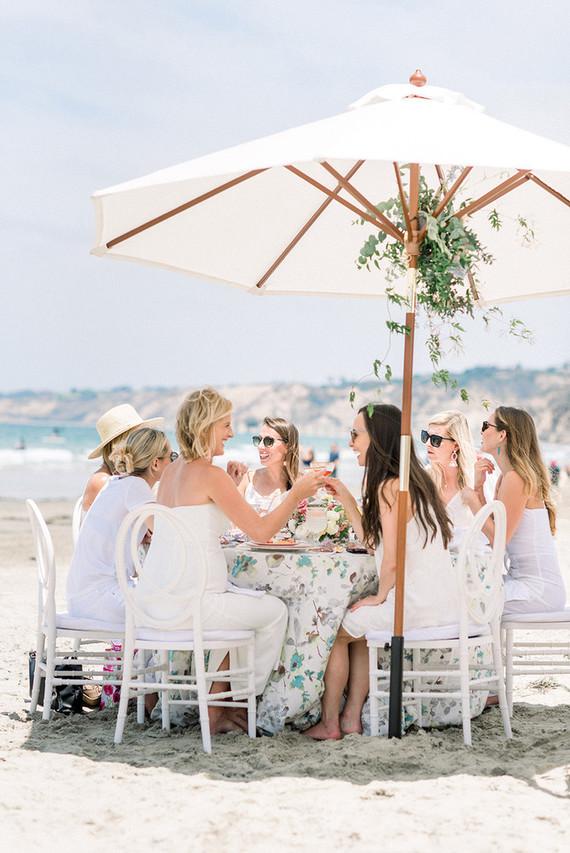 All white gender surprise beach baby shower in La Jolla