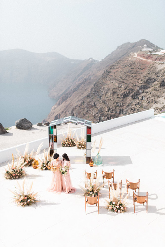 The most stunning stained glass ceremony on the cliffs of Santorini