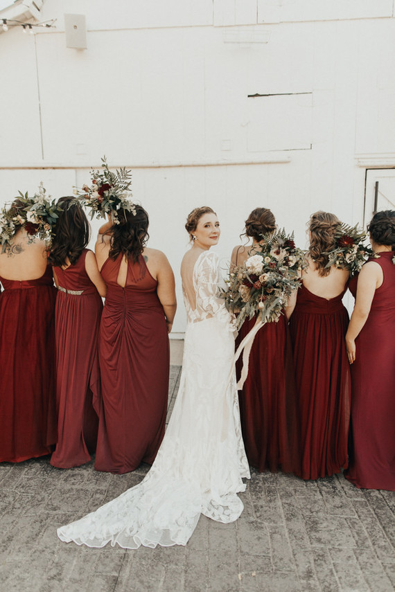 burgundy bridesmaid dresses at dreamy white barn venue in Kansas City