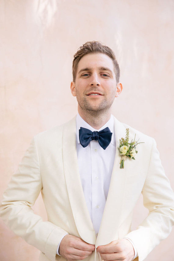 Groom with a white dinner jacket