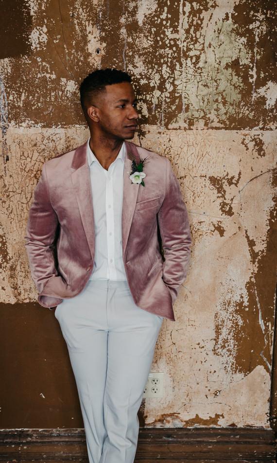 Fashion-forward groom style with a mauve jacket
