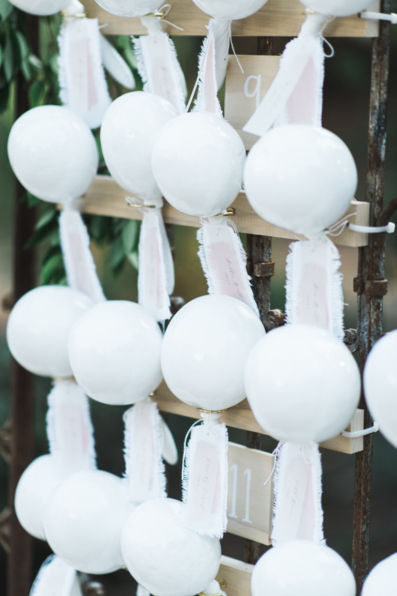 all white maraca escort card display