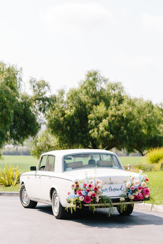 vintage Rolls Royce wedding car with flowers