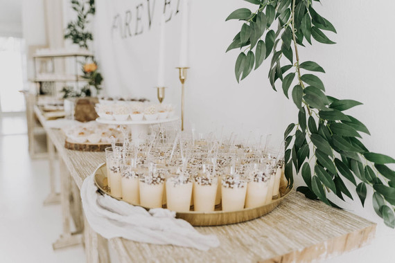 All white olive branch bridal shower with an epic grazing table