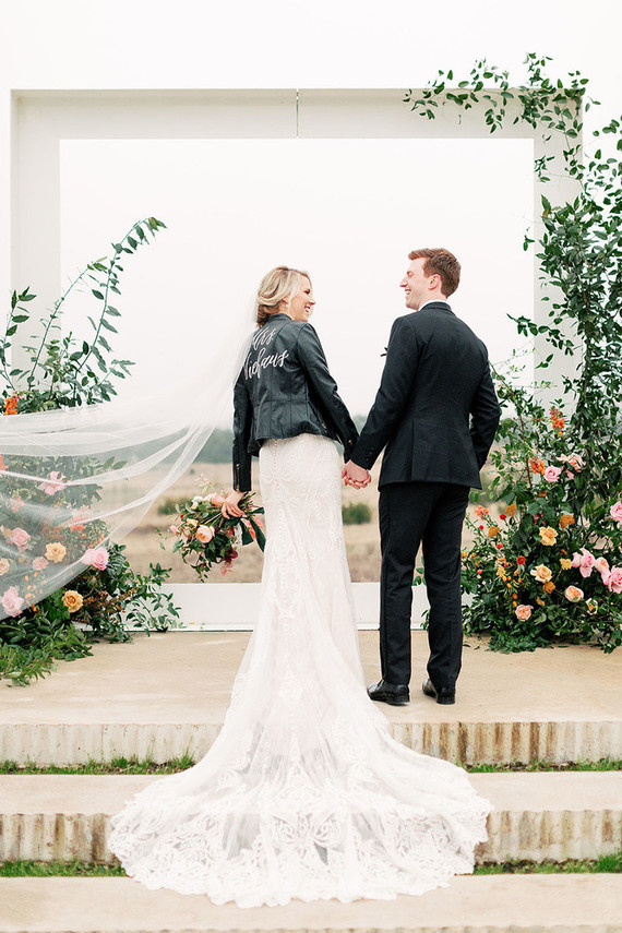 Bride with a custom leather jacket at the Prospect House in Austin Texas