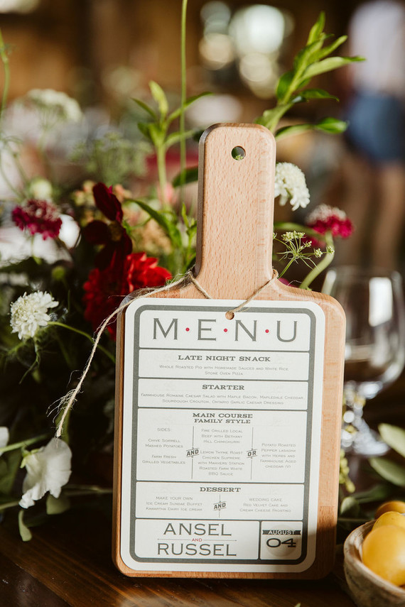 Cutting board wedding details for barn wedding