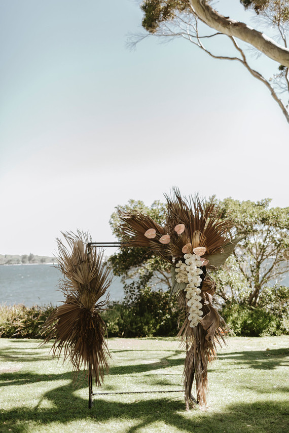 Palm leaf ceremony arch