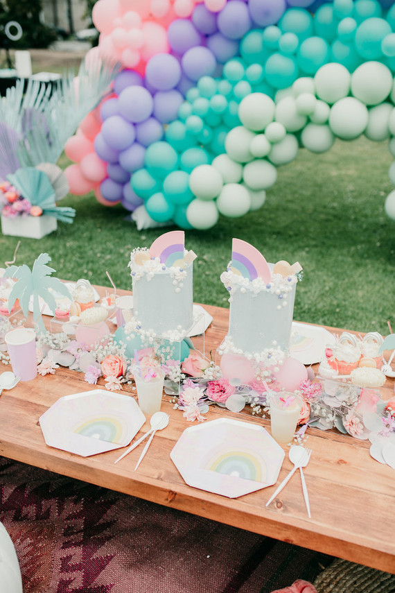 Rainbow twin birthday cakes