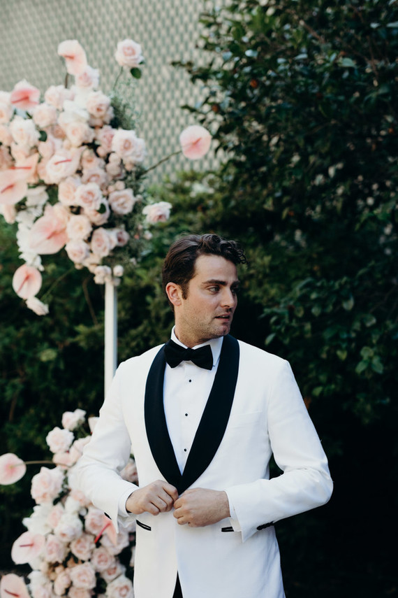 White + black groom's tux