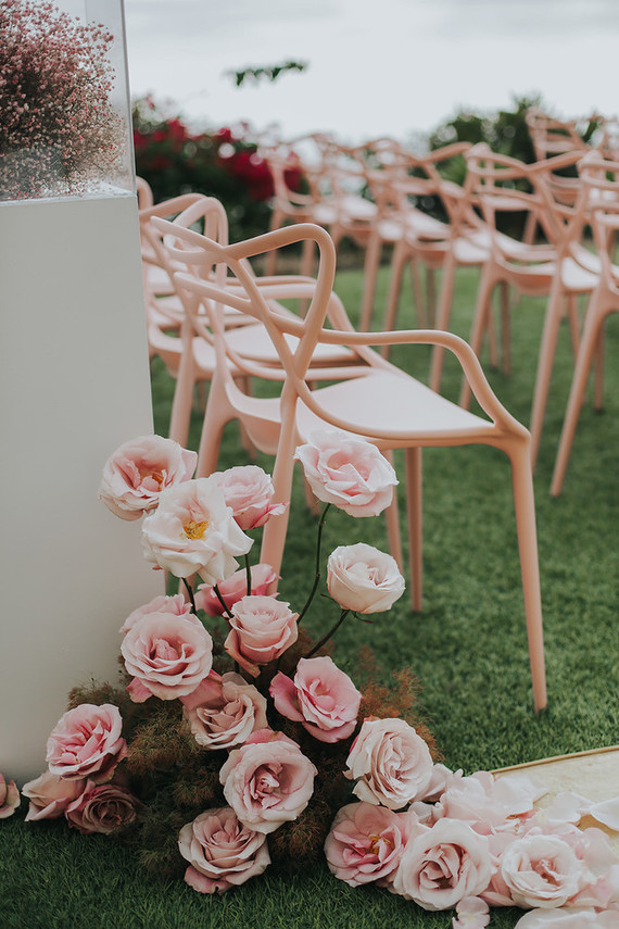 Gorgeous pink roses for wedding aisle