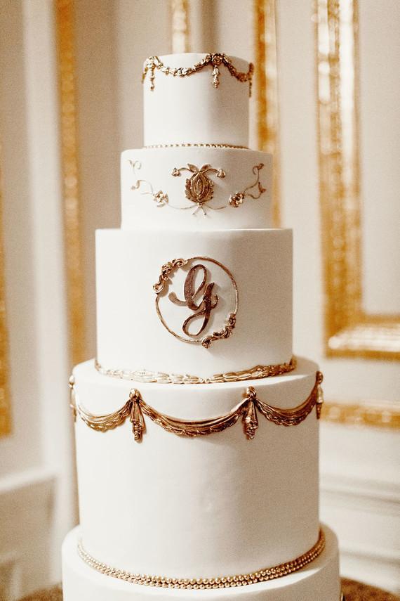Elegant gold and white wedding cake