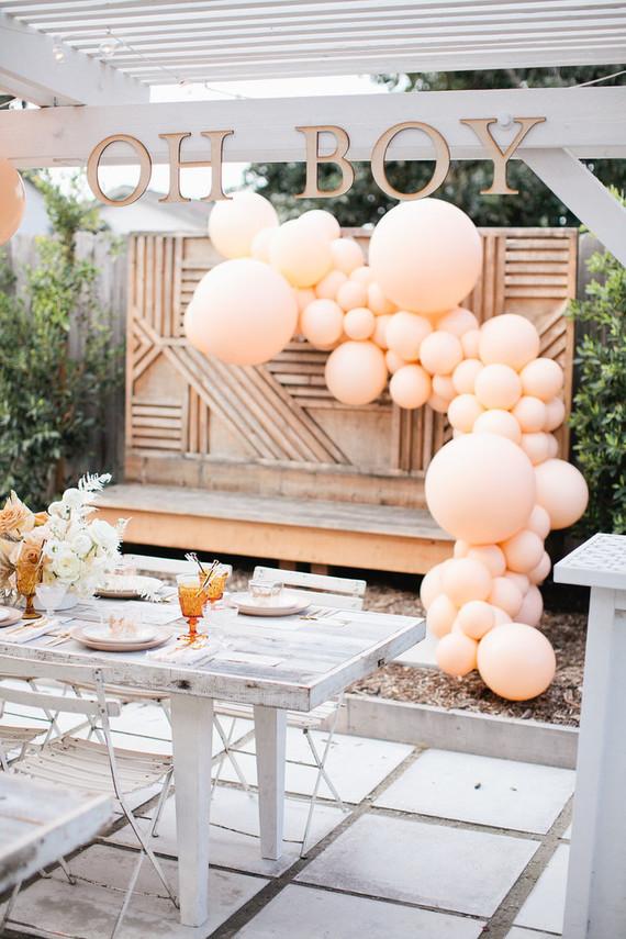 Peach balloon installation for baby shower