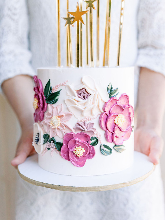 Floral 1st birthday cakes