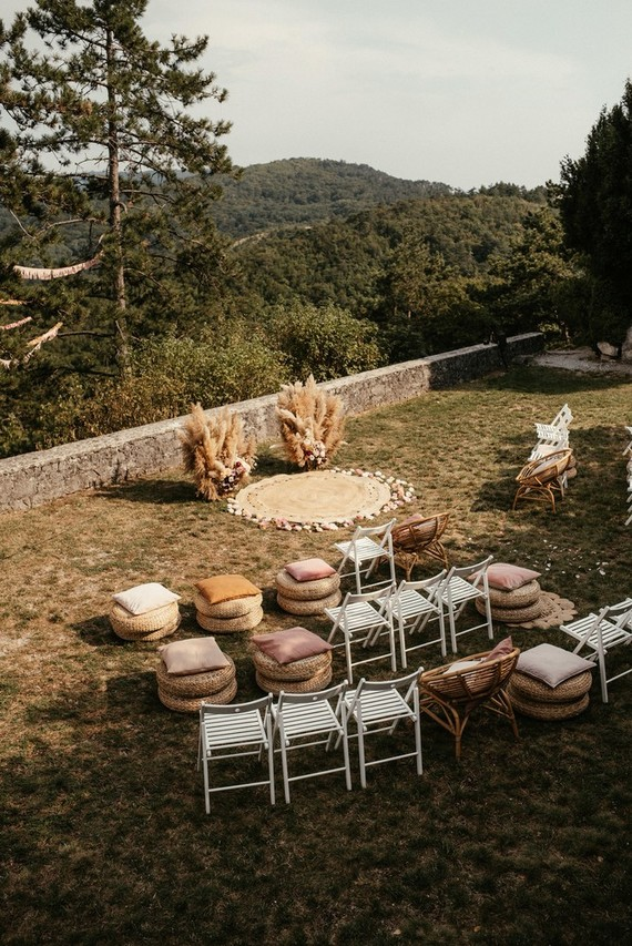 Modern bohemian wedding ceremony with pampas grass