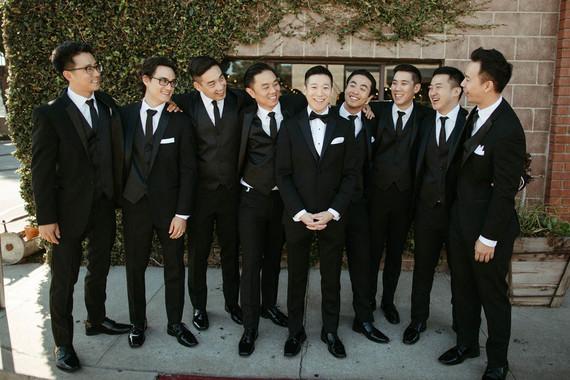 groomsmen in all black