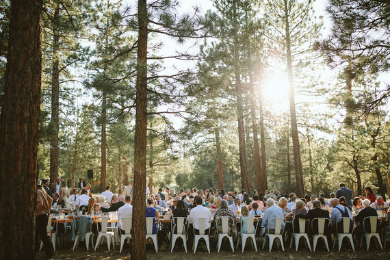 long reception table in forest wedding