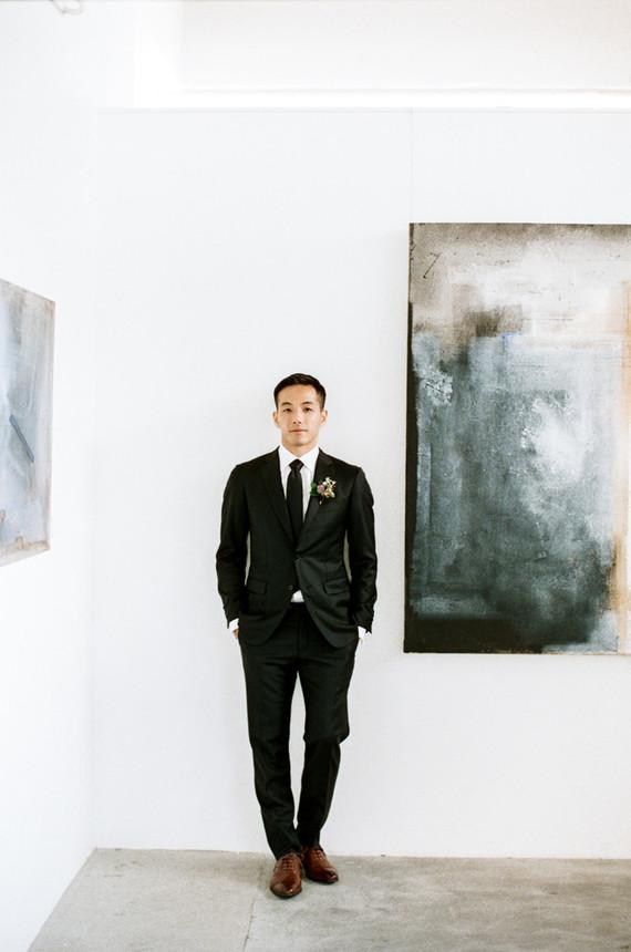 modern black groom's suit