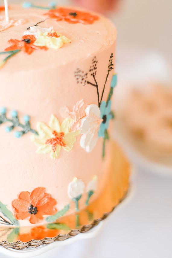 floral peach 1st birthday cake