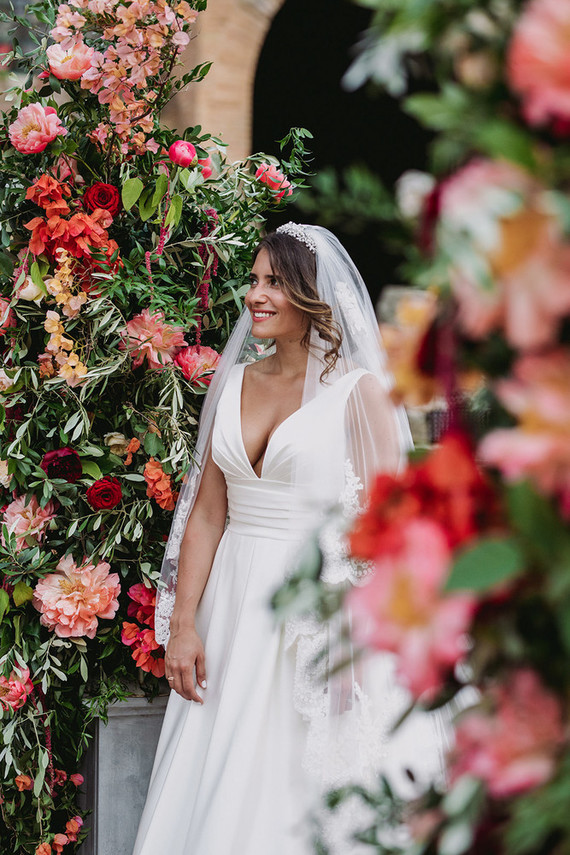 coral charm peony ceremony arch