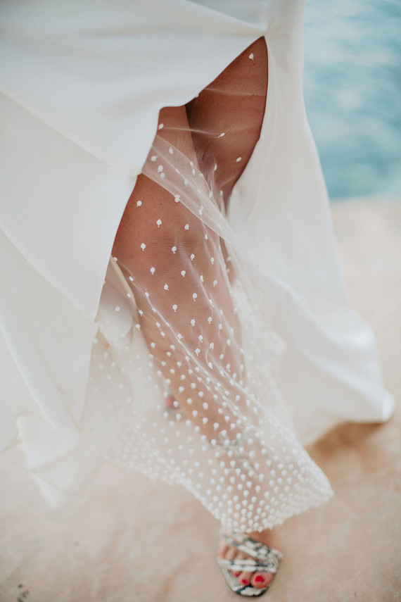 Wedding dress with sheer slit